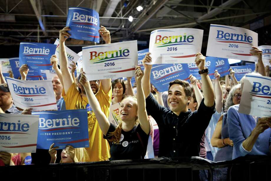 In this July 6, 2015, photo, supporters of Democratic presidential candidate Sen. Bernie Sanders, I-Vt., cheer at a campaign rally in Portland, Maine. Sanders is packing 'em in: 10,000 people in Madison, Wisconsin. More than 2,500 in Council Bluffs, Iowa. Another 7,500 this week in Portland. The trick for the independent senator from Vermont is to turn all that excitement into something more than a summer fling.(AP Photo/Robert F. Bukaty) Photo: Robert F. Bukaty, STF / AP
