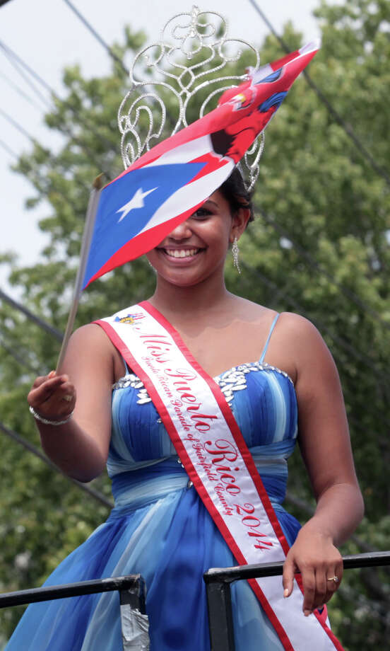 Miss Puerto Rico 2014 Thalia Perez during Puerto Rican Day Parade heads down Park Avenue in Bridgeport, Conn. on Sunday, June 13, 2014. The 2015 parade is this Sunday, July 12. Photo: BK Angeletti / B.K. Angeletti / Connecticut Post freelance B.K. Angeletti