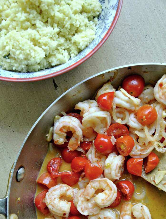 Garlicky shrimp are paired with sweet cherry tomatoes in this light summer dish. (Gretchen McKay/Pittsburgh Post-Gazette/TNS) ORG XMIT: 1170203 Photo: Gretchen McKay / Pittsburgh Post-Gazette