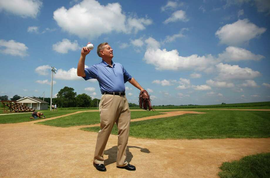 Republican presidential candidate Sen. Lindsey Graham, R-S.C., plays catch with children while visiting the Field of Dreams Movie Site, in Dyersville, Iowa. Graham is a rare candidate who does pander to win votes. Photo: Mike Burley /Associated Press / Telegraph Herald