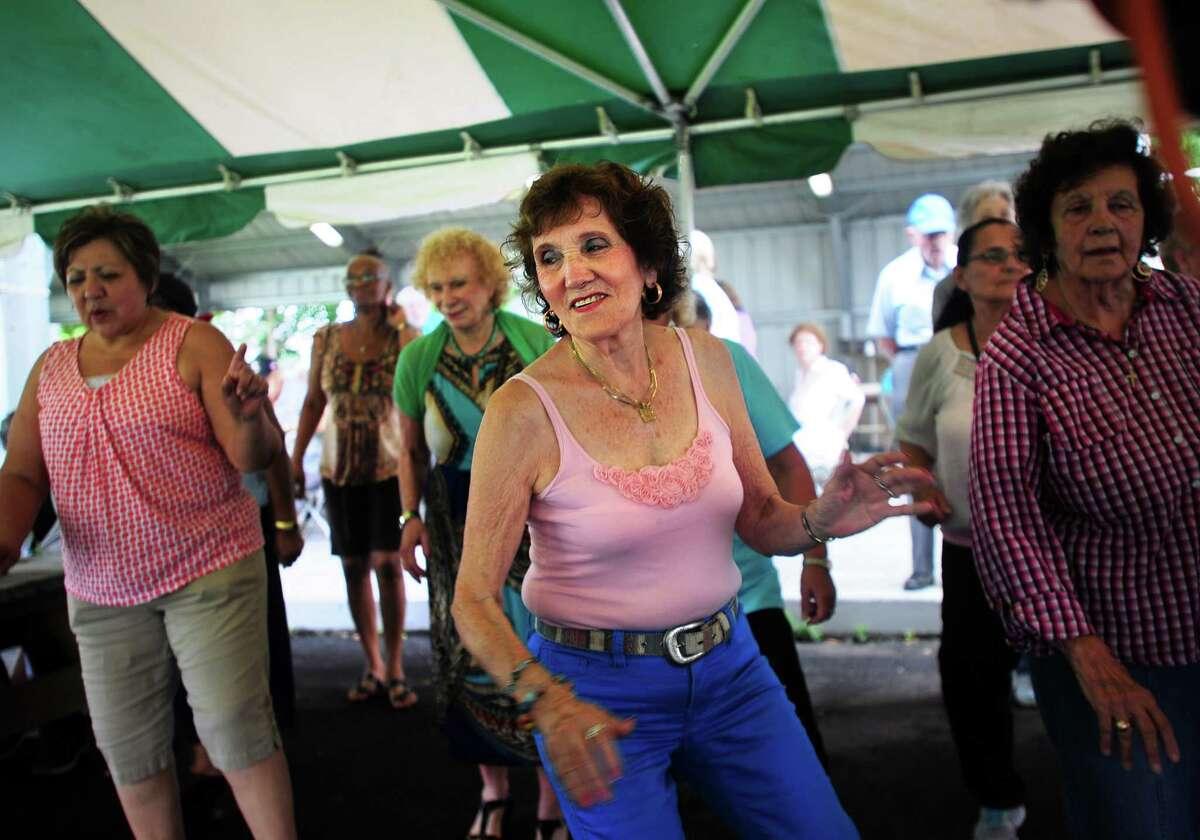 Marianne Muskus, of Newtown, line dances to Alan Jackson's