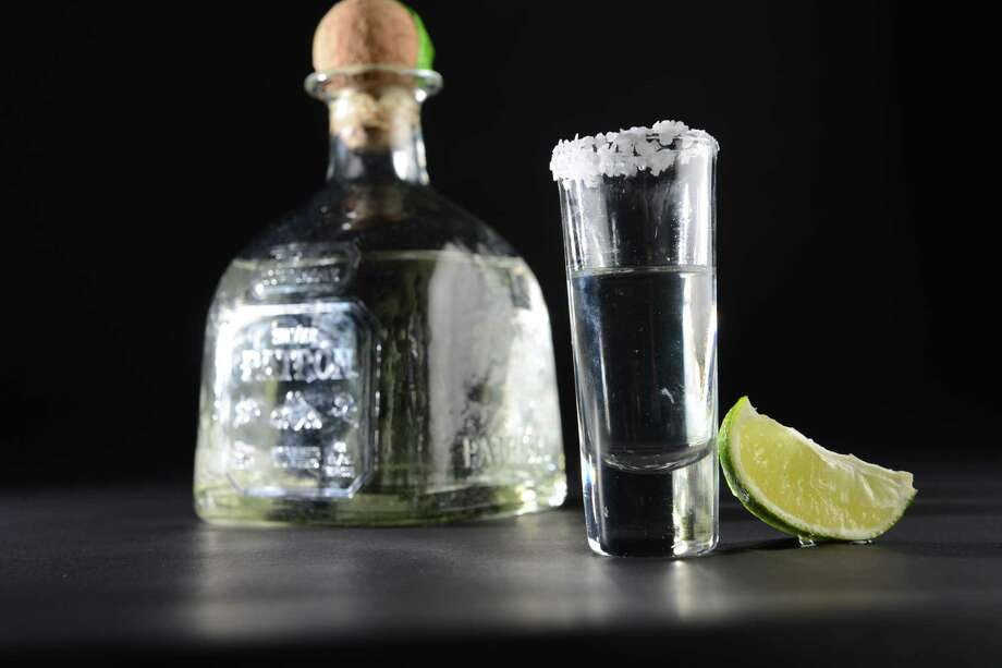 Shot glass of Patron tequila with lime Friday, July 3, 2015, at the Times Union in Colonie, N.Y. (Will Waldron/Times Union) Photo: WW / 00032472A