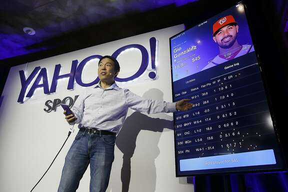 Kelly Hirano, vice president of engineering, demonstrates the Yahoo Sports Daily Fantasy contest during a product launch Wednesday, July 8, 2015, in San Francisco. Yahoo has designed this experience for the mobile fantasy player and offers Daily Fantasy, Full Season Fantasy, and real-time sports news and scores as an all-in-one experience. (AP Photo/Eric Risberg)