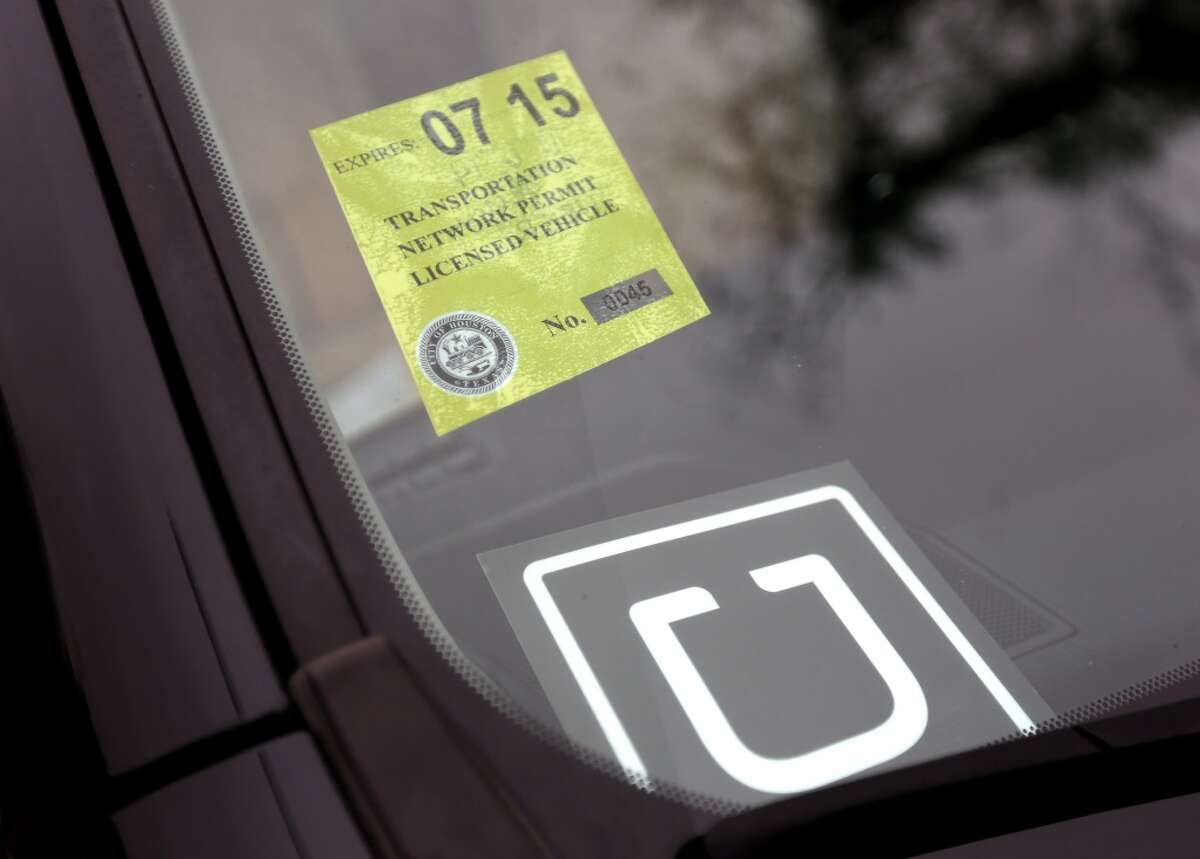 Houston began inspecting and issuing licenses for Uber drivers on Nov. 6, 2014. (Photo by Gary Coronado/ Houston Chronicle)