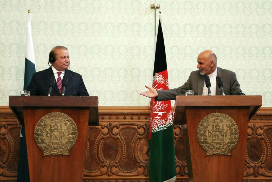 FILE - In a May 12, 2015 file photo, Afghan President Ashraf Ghani, right, speaks as Pakistani Prime Minister Nawaz Sharif listens during a joint press conference at the presidential palace in Kabul, Afghanistan. Pakistan said Wednesday, July 8, 2015, that the first official face-to-face discussions between Afghan government officials and the Taliban have made progress, with the two sides agreeing at a meeting near Islamabad to work on confidence-building measures and hold more such talks after the Muslim holy month of Ramadan. (AP Photo/Rahmat Gul, File) Photo: Rahmat Gul, STF / AP