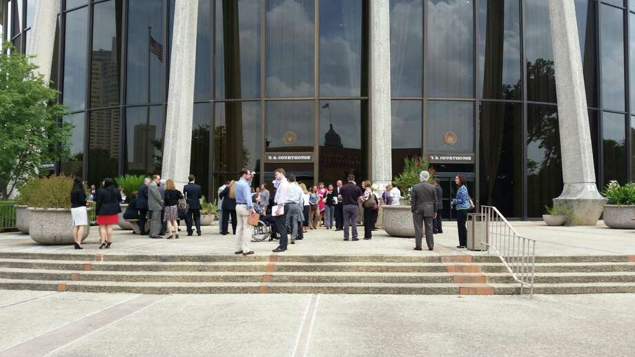 Federal court was evacuated and in- progress hearings postponed after a water line break from nearby construction on Wednesday afternoon triggered fire alarms in the building. Photo: Guillermo Contreras