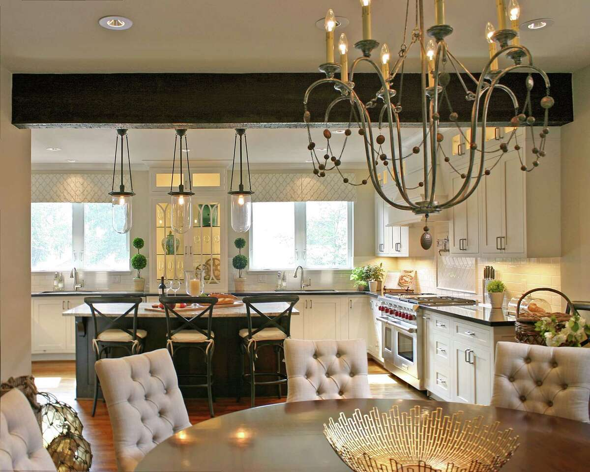Designer Ben Johnston hung the Devon chandelier by Arteriors Home above the dining table. It has a