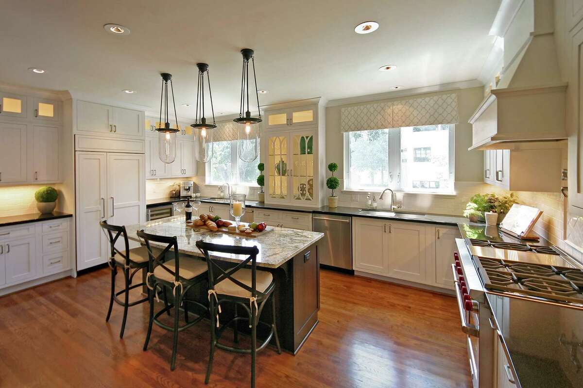 AFTER: To keep the room and counter tops neat, the microwave, a pull-out baking station and a recycling center are tucked away inside the island.