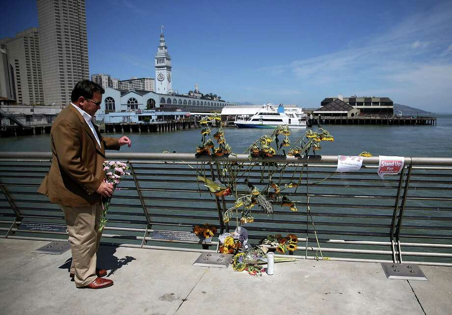 A well-wisher drops off flowers at the site where 32-year-old Kathryn Steinle was killed last week in San Francisco. Photo: Justin Sullivan / Getty Images / 2015 Getty Images
