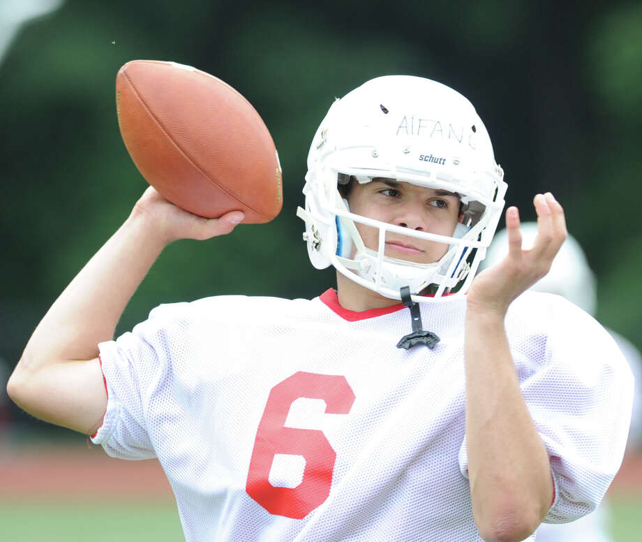 Red team quarterback Frank Alfano throws during the annual Red vs. White Greenwich High School football scrimmage at the school in Greenwich, Conn., Friday, June 12, 2015. Photo: Bob Luckey / Hearst Connecticut Media / Greenwich Time