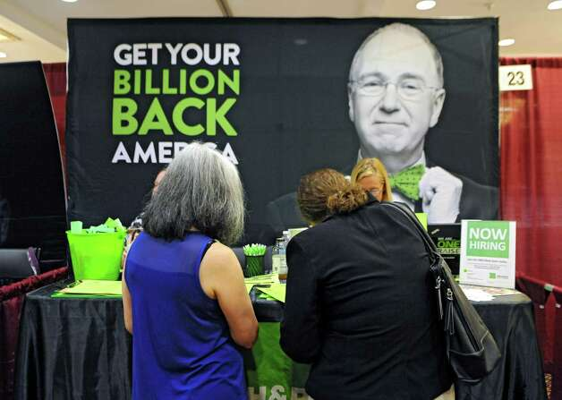 A woman fills out a form at the H and R Block booth during the Times Union job fair at the Albany Marriott Hotel on Wednesday, July 8, 2015 in Colonie, N.Y.  (Lori Van Buren / Times Union) Photo: Lori Van Buren / 00032511A