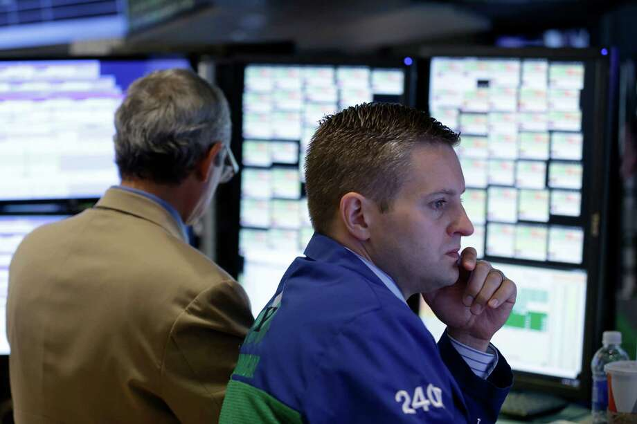 Traders work on the floor at the New York Stock Exchange in New York, Wednesday, July 8, 2015. Hong Kong's main stock index plummeted as much as 8.5 percent on Wednesday as a sell-off in mainland Chinese shares accelerated despite new measures to support the market; U.S. stocks were poised to open lower. (AP Photo/Seth Wenig) ORG XMIT: NYSW107 Photo: Seth Wenig / AP