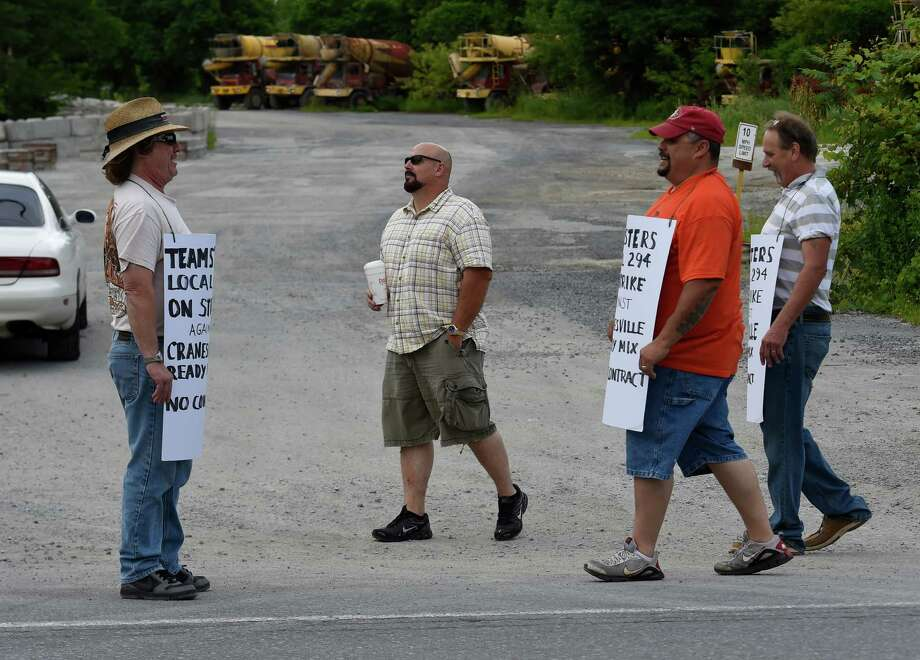 Members of Local 294 walk the picket line due to labor differences in front of Cranesville Concrete Wednesday morning July 8, 2015 in Scotia, N.Y.     (Skip Dickstein/Times Union) Photo: SKIP DICKSTEIN / 00032540A