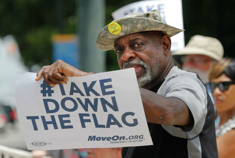 Theron Foster of Columbia, S.C., protests outside the South Carolina Statehouse during the House debate. Photo: John Bazemore / Associated Press / AP