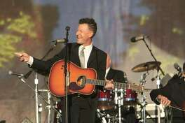 Lyle Lovett & His Large Band play to huge crowd at the Hardly Strictly Bluegrass Festival in San Francisco's Golden Gate Park on Friday.
