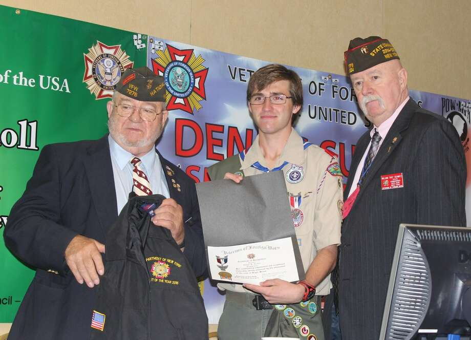 Olean Eagle Scout Ethan Kelley is flanked by Verl Ringgenberg, left, of the New York State Veterans of Foreign Wars Scouting Chairman, and state VFW Commander William ?Doc? Schmitz, after receiving the New York State VFW Scout of the Year Award in June at the Albany Marriott.