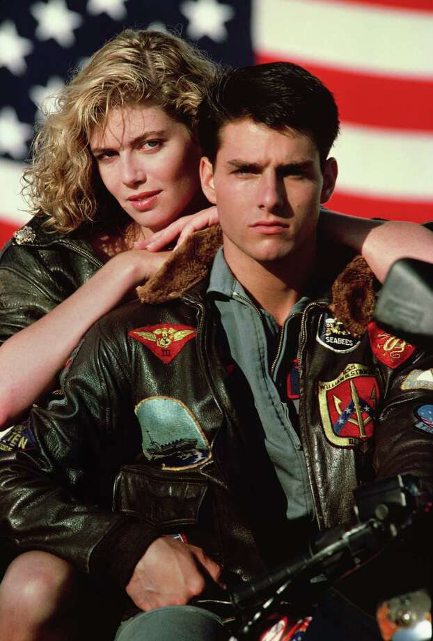 "Kelly McGillis and Tom Cruise in the movie ""Top Gun"" (Paramount Pictures) / TM,® &Copyright ©2003 By Paramount Pictures All Rights Reserve"