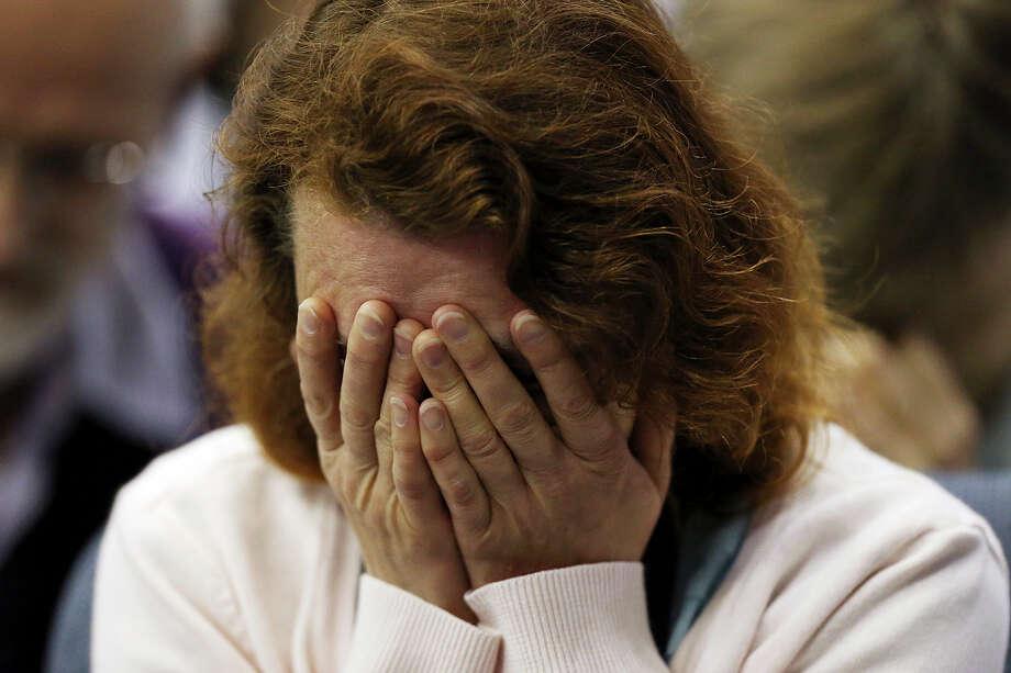 Alla Nommik, from the Baltics, prays after delegates voted against allowing women as clergy. Photo: Jerry Lara / San Antonio Express-News / © 2015 San Antonio Express-News