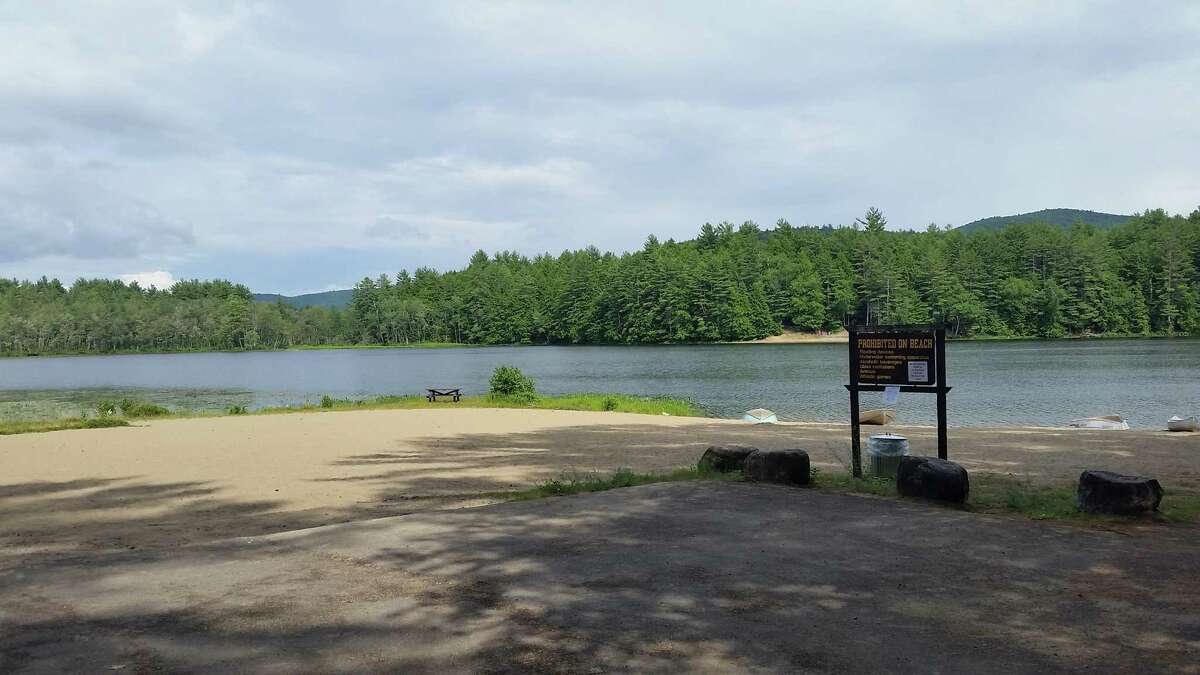The empty beach along Fourth Lake at the Luzerne Campground in Lake Luzerne. Swimming at the beach is prohibited because the state has been unable to find a lifeguard. (Photo by Chris Churchill / Times Union)
