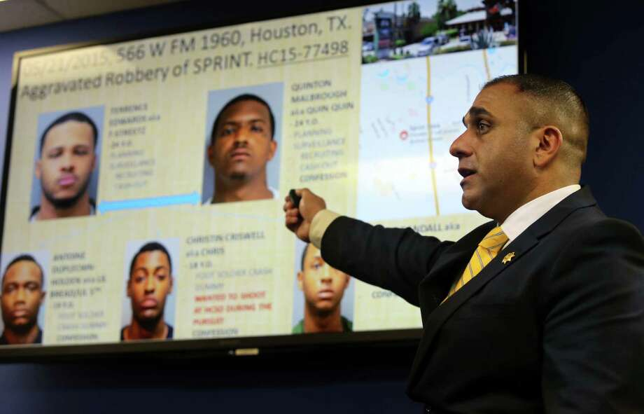 Deputy Ben Katrib with the Harris County Sheriff's Office Robbery Division announces the charging and arrests of 24 adults and two juveniles involved in cellphone store robberies. Photo: Mayra Beltran, Staff / © 2015 Houston Chronicle