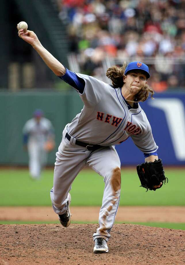 New York Mets pitcher Jacob deGrom throws against the San Francisco Giants during the seventh inning of a baseball game in San Francisco, Wednesday, July 8, 2015. (AP Photo/Jeff Chiu) ORG XMIT: FXPB108 Photo: Jeff Chiu / AP