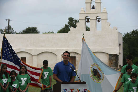 San Antonio YMCA Chief Operating Officer Matt Mitchell (at lectern) speaks Wednesday July 8, 2015 at Mission San Juan during a press conference regarding a youth initiative with the YMCA. The initiative encourages area youth to to get involved in community service and volunteerism and to protect public lands. Photo: John Davenport, Staff / San Antonio Express-News / ©San Antonio Express-News/John Davenport