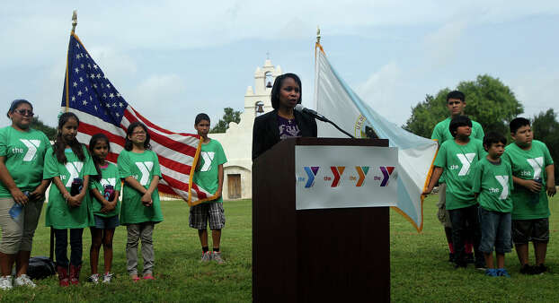 San Antonio mayor Ivy Taylor (at lectern) speaks Wednesday July 8, 2015 at Mission San Juan during a press conference regarding a youth initiative with the YMCA. The initiative encourages area youth to to get involved in community service and volunteerism and to protect public lands. Photo: John Davenport, Staff / San Antonio Express-News / ©San Antonio Express-News/John Davenport