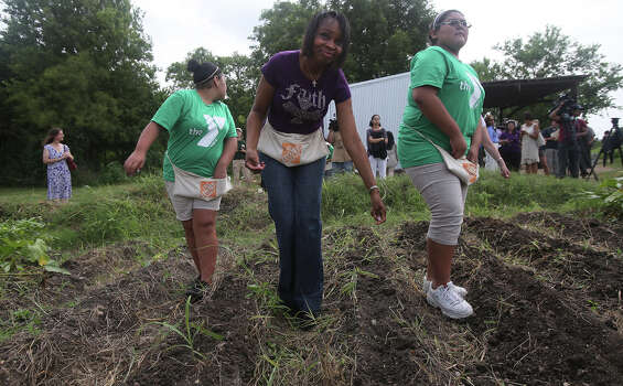 San Antonio mayor Ivy Taylor (center) plants seeds Wednesday July 8, 2015 near Mission San Juan after a press conference regarding a youth initiative with the YMCA. The initiative encourages area youth to to get involved in community service and volunteerism and to protect public lands. Photo: Photos By John Davenport / San Antonio Express-News / ©San Antonio Express-News/John Davenport