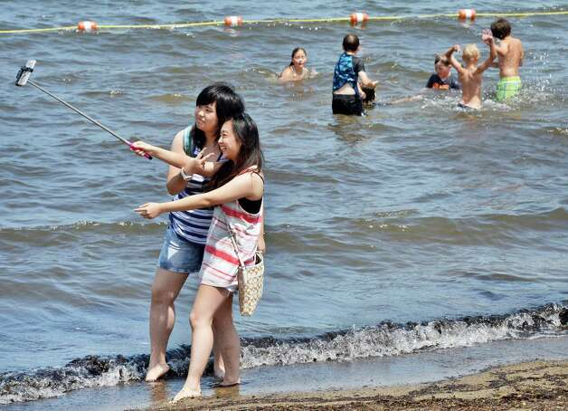 Rachel Yang, left, and Vivian Wu, both of Taiwan, take a selfie on Million Dollar Beach Wednesday July 8, 2015 in Lake George, NY.  (John Carl D'Annibale / Times Union) Photo: John Carl D'Annibale
