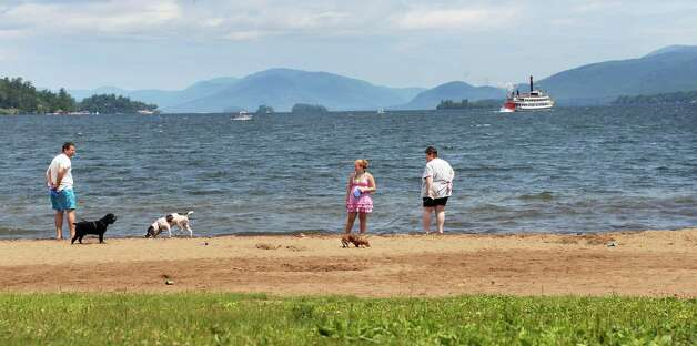 Dog walkers along the shores of Lake George Wednesday July 8, 2015 in Lake George, NY.  (John Carl D'Annibale / Times Union) Photo: John Carl D'Annibale
