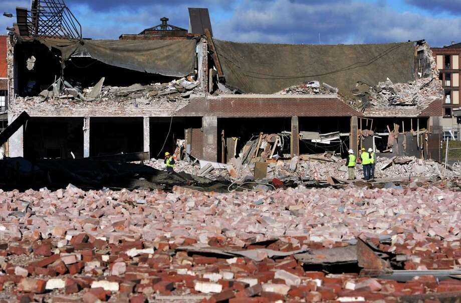 Inspectors assess damage in the area of a gas explosion at a strip club in Springfield, Mass., in 2012. The Obama administration has moved to expand a requirement for inexpensive safety valves on natural gas lines.  Photo: Jessica Hill, FRE / FR125654 AP