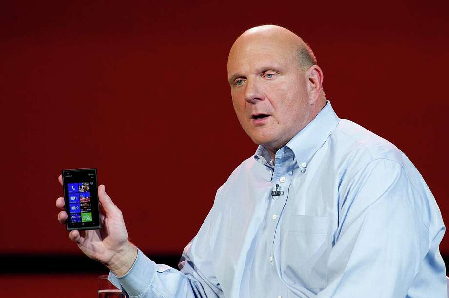 Former Microsoft CEO Steve Ballmer, with a Nokia phone, pushed for the Nokia deal in 2013. Photo: David Paul Morris, 963182 / 2012 Bloomberg Finance LP