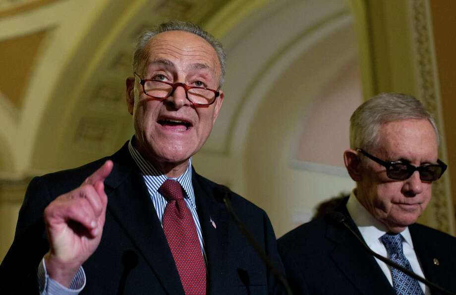 Sen. Charles Schumer, D-N.Y., joined by Senate Minority Leader Sen. Harry Reid of Nev., right, speaks to media after a policy luncheon on Capitol Hill in Washington, Wednesday, July 8, 2015. Senators unveiled a bipartisan framework aimed at making business taxes more competitive while generating much-needed funding to repair the nation's roads and bridges. (AP Photo/Carolyn Kaster) Photo: Carolyn Kaster, STF / AP