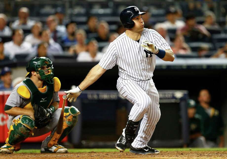NEW YORK, NY - JULY 08: Mark Teixeira #25 of the New York Yankees hits a home run against the Oakland Athletics during the sixth inning of a MLB baseball game at Yankee Stadium on July 8, 2015 in the Bronx borough of New York City. (Photo by Rich Schultz/Getty Images) ORG XMIT: 538586415 Photo: Rich Schultz / 2015 Getty Images