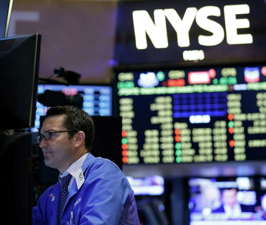 Traders work on the floor at the New York Stock Exchange in New York, Wednesday, July 8, 2015. Hong Kong's main stock index plummeted as much as 8.5 percent on Wednesday as a sell-off in mainland Chinese shares accelerated despite new measures to support the market; U.S. stocks were poised to open lower. (AP Photo/Seth Wenig) Photo: Seth Wenig, STF / AP