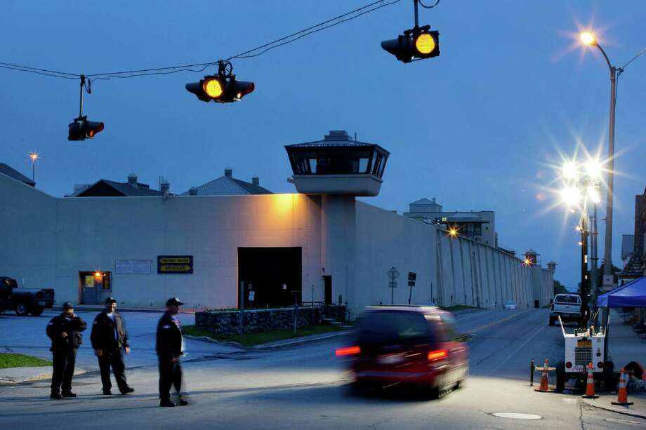 Corrections officers watch an intersection in front of the Clinton Correctional Facility, Monday, June 15, 2015 in Dannemora, N.Y. State police say more than 800 law enforcement officers are pushing on in the hunt for convicted murderers David Sweat and Richard Matt 10 days after the two escaped from the maximum-security prison in rural New York. (AP Photo/Mark Lennihan) ORG XMIT: NYML101 Photo: Mark Lennihan / AP
