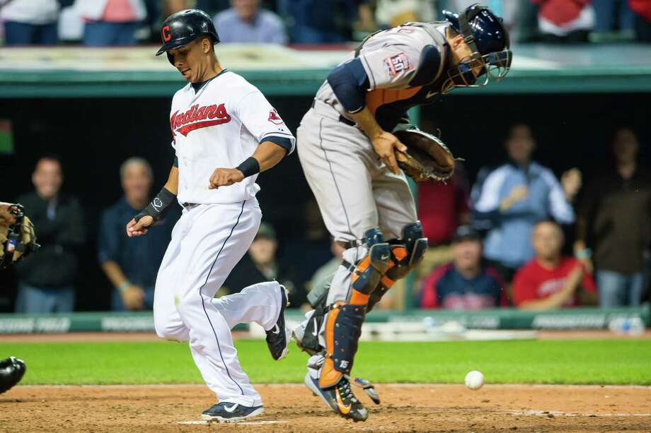 The Indians' Michael Brantley, left, scores the second of two runs on a tiebreaking, eighth-inning double by David Murphy in Cleveland's 4-2 win over the Astros on Wednesday. Photo: Jason Miller, Stringer / 2015 Getty Images