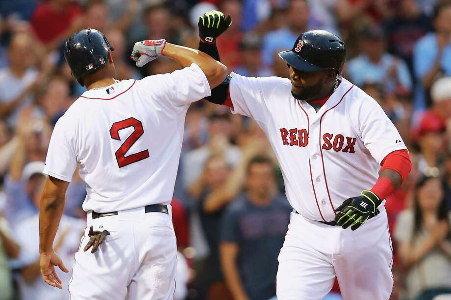 BOSTON, MA - JULY 08:  David Ortiz #34 of the Boston Red Sox celebrates with Xander Bogaerts #2 after hitting a two run homer during the third inning against the Miami Marlins at Fenway Park on July 8, 2015 in Boston, Massachusetts.  (Photo by Maddie Meyer/Getty Images) ORG XMIT: 538586451 Photo: Maddie Meyer / 2015 Getty Images