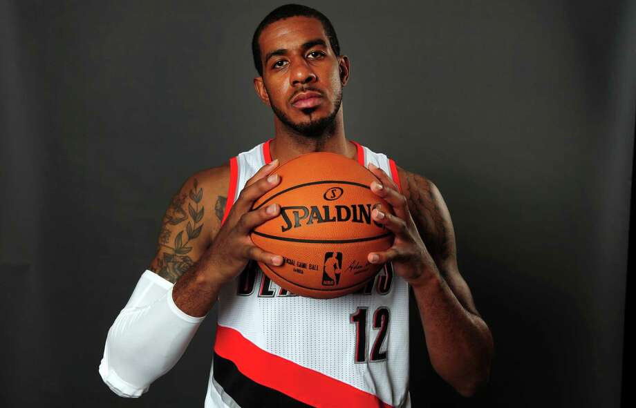 LaMarcus Aldridge visited several teams but cast his lot with the one that was the favorite to land him all along. Photo: Steve Dykes, FRE / FR155163 AP