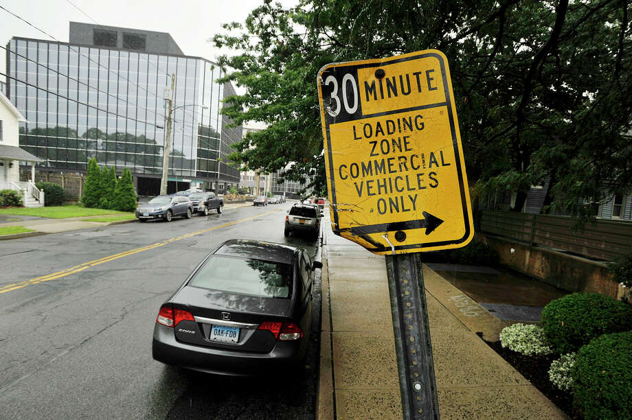 A commercial loading zone sign can be seen on Oak Street in Stamfor on Wednesda. The city is increasing many of the parking fines. Photo: Jason Rearick / Hearst Connecticut Media / Stamford Advocate