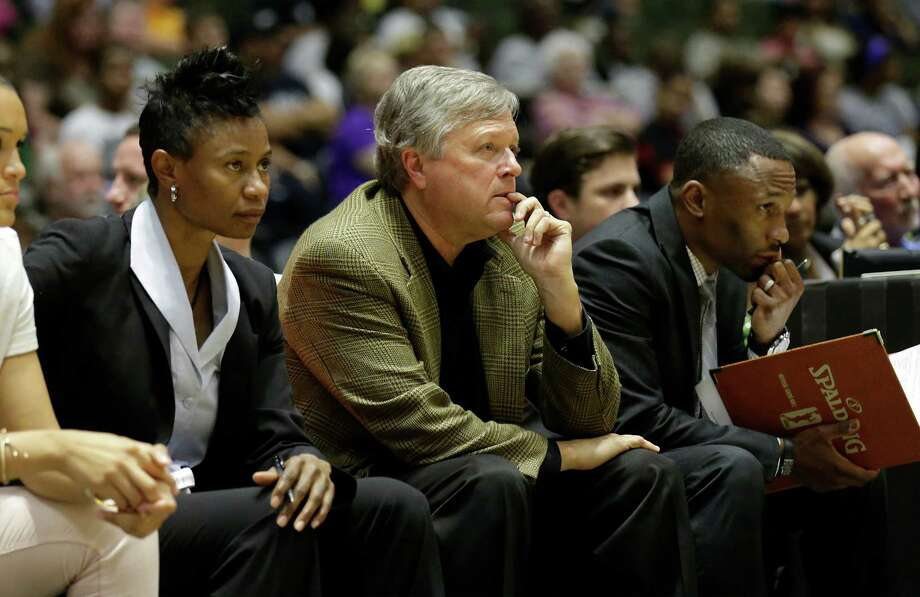 Stars' head coach Dan Hughes (center) with assistants Vickie Johnson (left) and James Wade oversee the game against the Los Angeles Sparks at the Freeman Coliseum on Wednesday, July 8, 2015. (Kin Man Hui/San Antonio Express-News) Photo: Kin Man Hui, Staff / San Antonio Express-News / ©2015 San Antonio Express-News