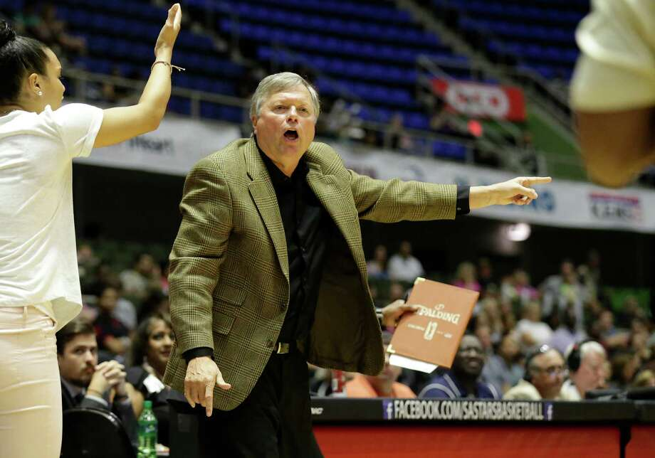 Stars' head coach Dan Hughes contests a turnover with game officials in the game against the Los Angeles Sparks at the Freeman Coliseum on Wednesday, July 8, 2015. (Kin Man Hui/San Antonio Express-News) Photo: Kin Man Hui, Staff / San Antonio Express-News / ©2015 San Antonio Express-News
