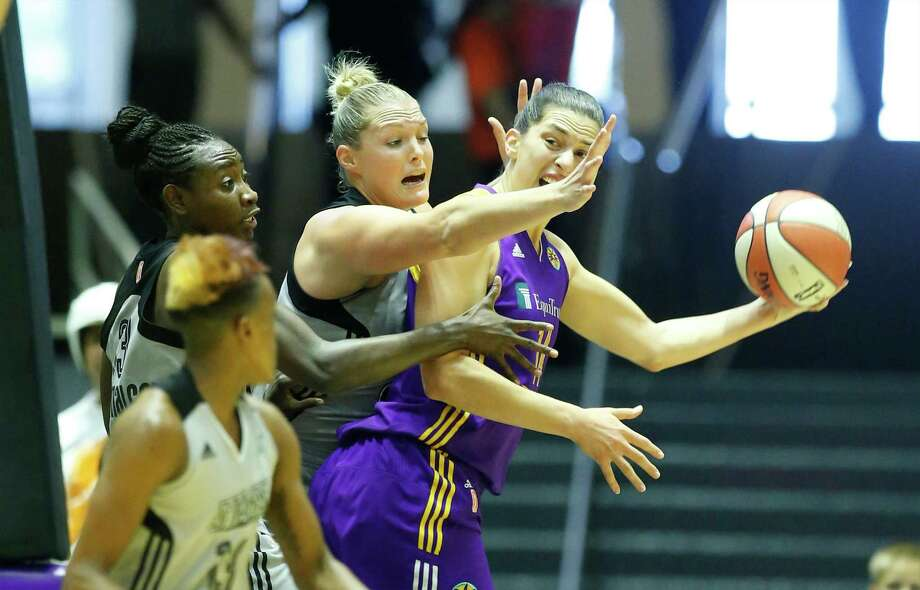 Los Angeles Sparks' Marianna Tolo (14) gets defensive pressure from Jayne Appel (32), Sophia Young-Malcolm (33) and Danielle Robinson (13) at the Freeman Coliseum on Wednesday, July 8, 2015. (Kin Man Hui/San Antonio Express-News) Photo: Kin Man Hui, Staff / San Antonio Express-News / ©2015 San Antonio Express-News