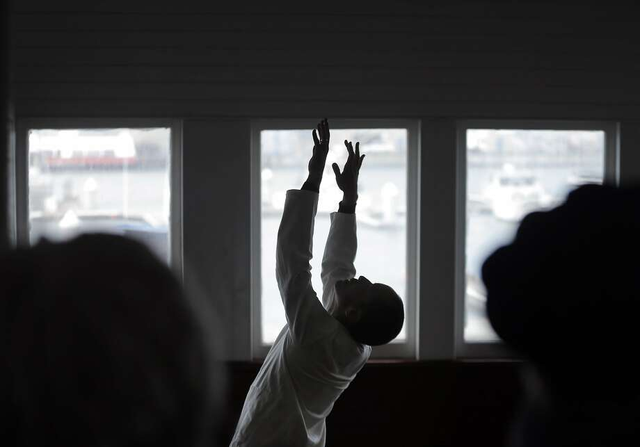 "Shinichi Iova-Koga performs as Inkboat presented ""95 Rituals"" aboard the Eureka, a site specific tribute to Anna Halprin to honor her 95th birthday, at the Hyde Street Pier. Photo: Carlos Avila Gonzalez, The Chronicle"