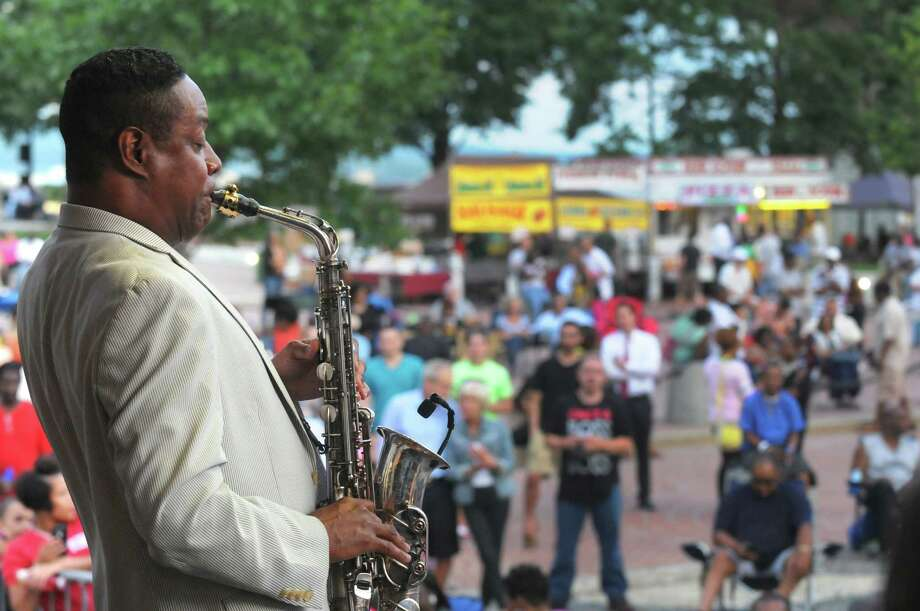 Saxophonist Kim Waters performs during the Capital Concert Series Presented by Saranac at the Empire State Plaza on Wednesday July 8, 2015 in Albany, N.Y. (Michael P. Farrell/Times Union) Photo: Michael P. Farrell / 00032541A