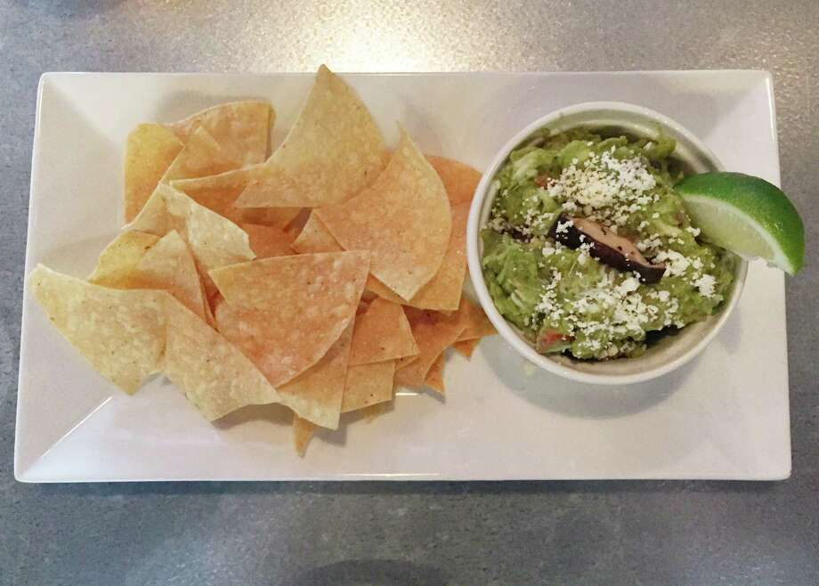 The untraditional Brown Butter Guac is made of   crab meat, roasted garlic, brown butter, chile de arbol, shiitake mushroom and green onions Photo: Edmund Tijerina / San Antonio Express-News