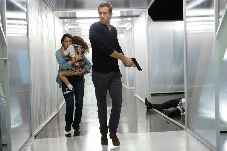 "From left, Madeline (Natalie Martinez) and daughter Anna (Jaynee-Lynne Kinchen) flee with Young Damian (Ryan Reynolds) in Gramercy Pictures' ""Self/less."" (Alan Markfield/Gramercy Pictures) Photo: Alan Markfield, HO / McClatchy-Tribune News Service / Gramercy Pictures"