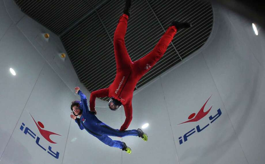Bret Stuart 'free falls' with the help of skydiver Rory Corrigan in the wind tunnel while skydiving at the new iFLY Indoor Skydiving facility on Thursday, Jan. 8, 2015, in Houston. The west Houston facility is the first of two vertical wind tunnels that iFLY will open in the Houston area. A second location is planned to open in the first quarter of 2015 near the Woodlands. ( Mayra Beltran / Houston Chronicle ) Photo: Mayra Beltran, Staff / © 2015 Houston Chronicle
