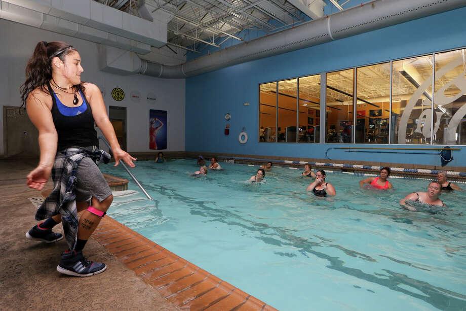 Tori Martinez (left) leads an Aqua Zumba class at Gold's Gym, 7650 FM 78, on Friday, June 26, 2015. Photo: Marvin Pfeiffer /San Antonio Express-News / Express-News 2015