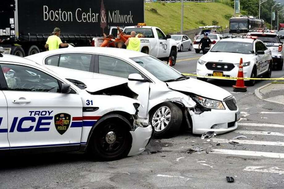 Troy police investigate a collision between a police car and a private car on Thursday, July 9, 2015, on Hoosick Street. The police officer was injured. (Skip Dickstein/Times Union)